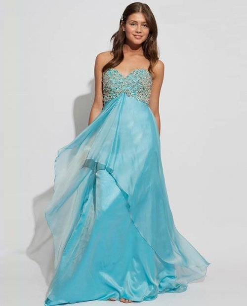 long blue prom dress by jovani with embellished top