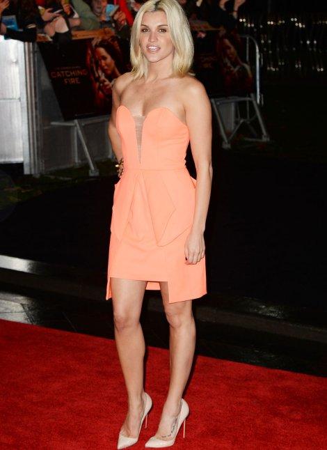 Ashley Robertsin  strapless peachy dress