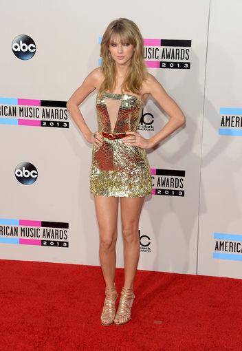 Taylor Swift wore a sparkling gold Julien Macdonald