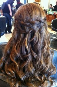 curly long hairstyle for prom with braid