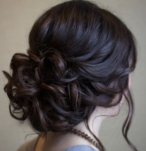 Beautiful low prom updo hairstyle with loose soft curls Ofuku hairstyle hairstyle worn by senior maiko in their final two